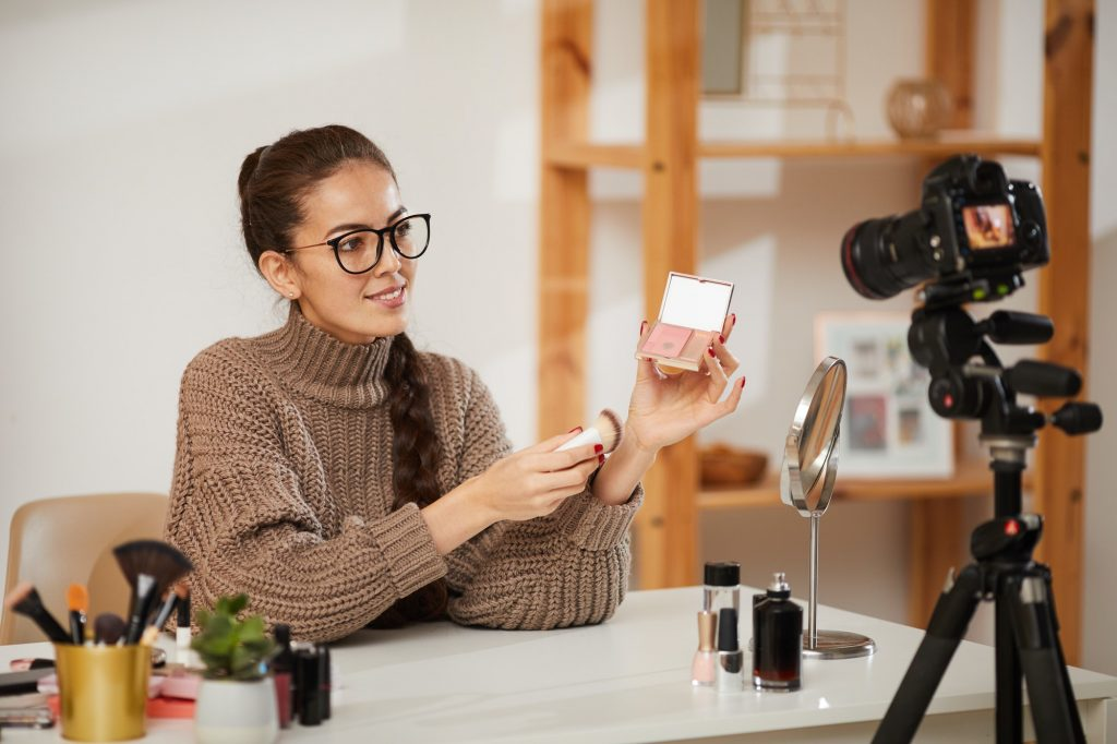 Young Woman Testing Beauty Products for Video